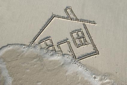 home being swept away flood sand beach