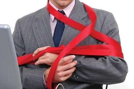 Man tied up red tape