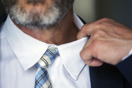 Nervous man pulling collar